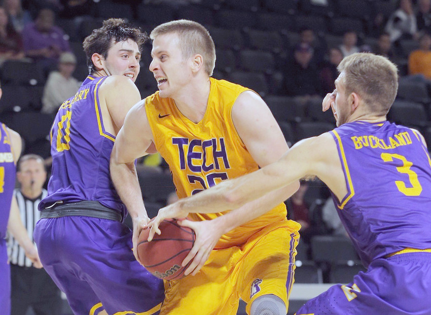 Tennessee Tech's Mason Ramsey, center, fights through two Lipscomb defenders during the Golden Eagles' 86-80 victory on Wednesday night in the Hooper Eblen Center.