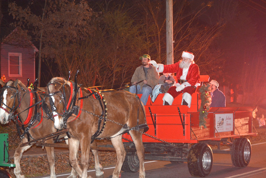 Santa Claus waves to the crowd lining the streets lFriday at the Baxter parade