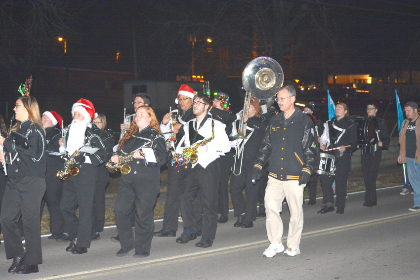 The Upperman High School marching band performs for the Baxter parade crowd Friday.