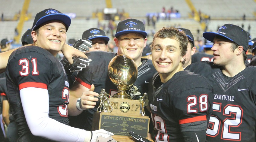 The Maryville High School Rebels celebrate after wining the TSSAA Class 6A State Championship on Friday at Tennessee Tech's Tucker Stadium.