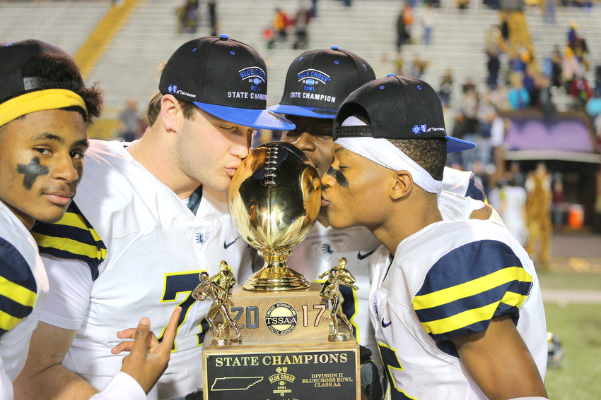 Players Lausanne kiss the championship trophy Saturday night after beating Notre Dame for the state championship.