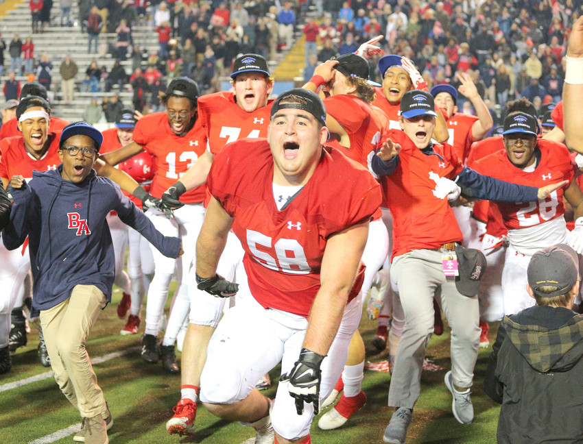 Brentwood Academy players rush the field after the Eagles beat Montgomery Bell for the Division II, Class 3A title Saturday.