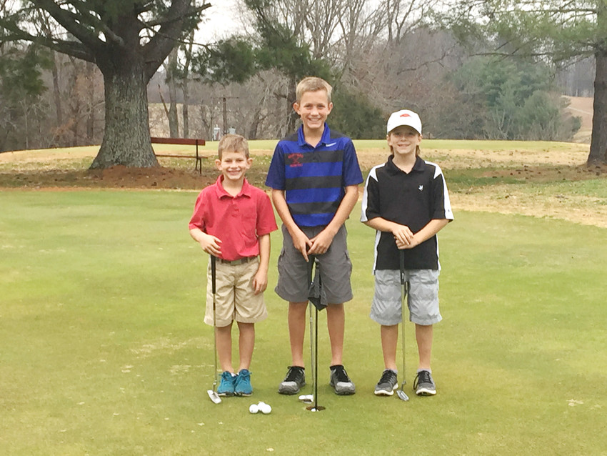 Colt, Jud and Hunt Reese, the sons of Molly and Barry Reese, take a break from their putting to pose for a picture at Ironwood Golf Course. The Reeses are the new owners of the course.