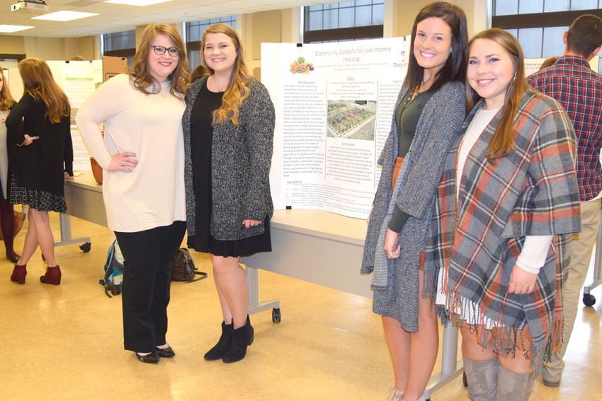 "Chelsey James, Ashley Taylor, Ashtin Banks and Savannah Rippetoe with their project, ""Community Gardens for Low Income Housing."""