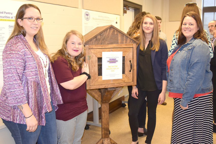 TTU students Valerie Caswell, Shelby Brock, Lindsey Robinson and Latisha Scarlett with their underground food pantry.
