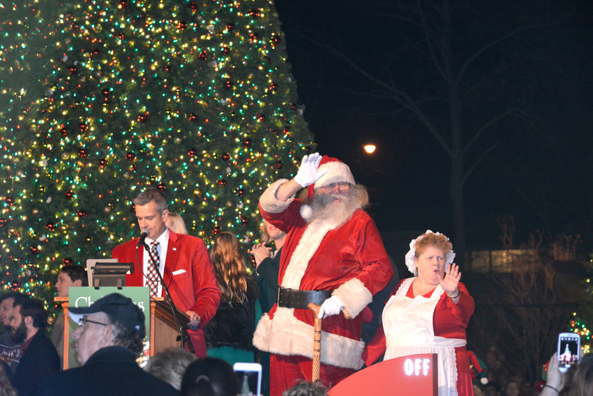 Santa Claus and Mrs. Claus wave to the crowd during the Dogwood park tree lighting Sunday evening.