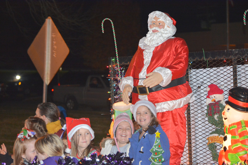 Children on a float smiling for the crowd during the Monterey Christmas Parade Saturday evening.
