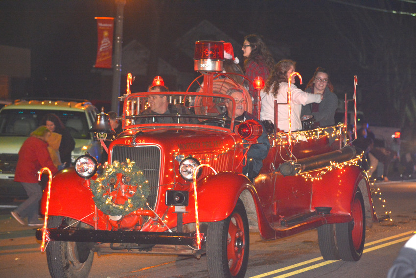 The Monterey Fire Department car driving through the streets during the Monterey Christmas  Parade Saturday evening.
