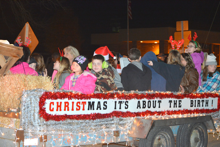 Another float filled with children smiling for the crowd during the Monterey Christmas Parade.