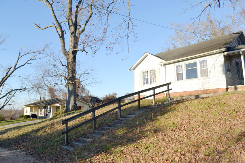 Two houses sit on property adjacent to the Putnam County school system's central office. The school board has declined an offer to purchase the property.