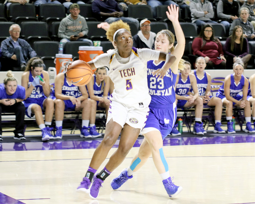 "Yaktavia ""Shug"" Hickson drives around a Tennessee Wesleyan defender during a game earlier this season. Hickson, who is only 15 points from reaching her 1,000th career point, uses a family bond for motivation."