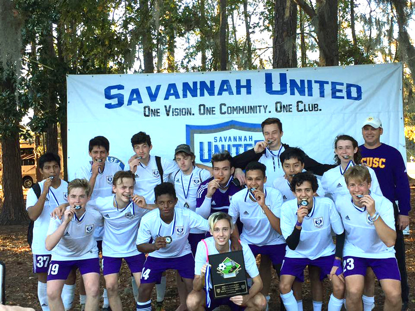Posing after their Adidas Savannah Senior Cup championship win are (front row, from left) Blake Burckhard, Cayden Wilcox, Teyo Rodriguez, Spencer Ing, Heitor Alves, Bryan Velasquez, Caio Brandao, Jackson Bilbrey, (back row, from left) Juan Martin, Gabe Aranda, Ryan Johnson, Casey Walker, Aron Cantu, Jared Turner, Drew Caldwell, and head coach Mark Caldwell
