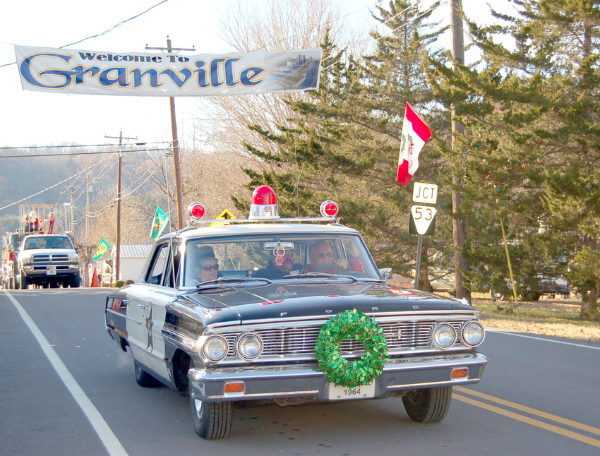 A car leads the Granville Christmas Parade in a previous year.