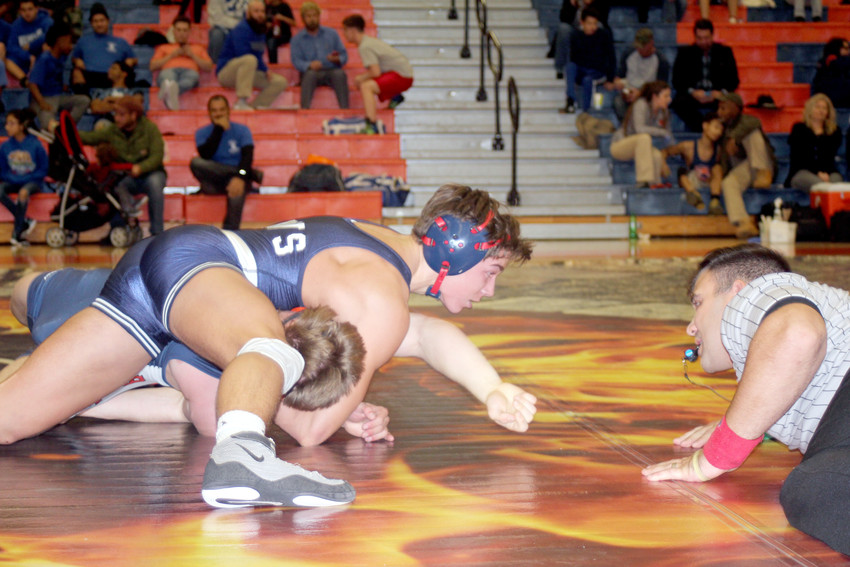 Cookeville's Hunter Harcum, top, goes for a pin against a Blackman wrestler during the Cavs' 54-24 loss to the Blaze on Tuesday night in Murfreesboro.