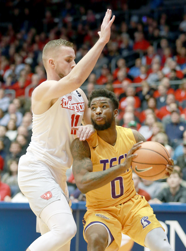 Tennessee Tech's Shaq Calhoun, right, tries to get space against a Dayton defender during the Golden Eagles' 79-66 loss on Wednesday night in Ohio.