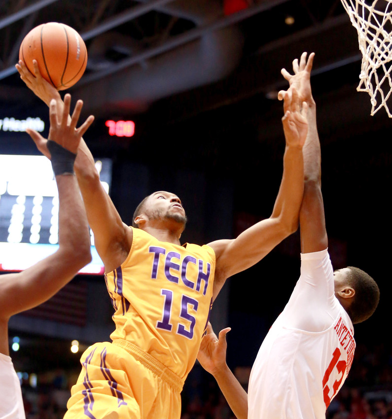 Tennessee Tech's Curtis Phillips Jr., left, goes to the rim for a layup against a Dayton defender during the Golden Eagles' 79-66 loss on Wednesday night in Ohio.