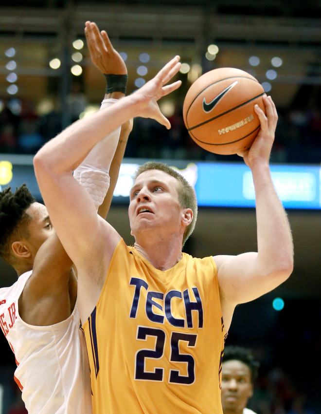 Tennessee Tech's Mason Ramsey, right, goes to the rim for a layup against a Dayton defender during the Golden Eagles' 79-66 loss on Wednesday night in Ohio.
