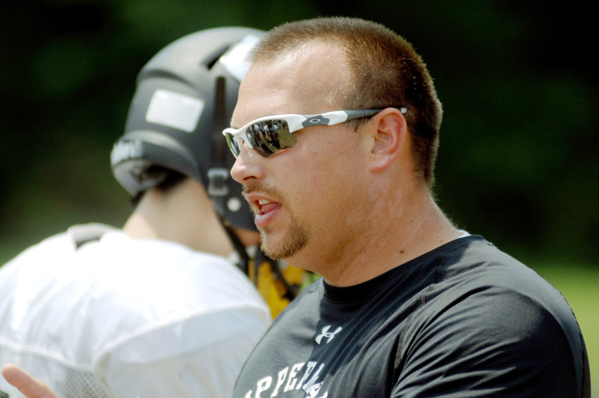 Former Upperman head football coach Ben Herron gives instruction during a practice in August at UHS.