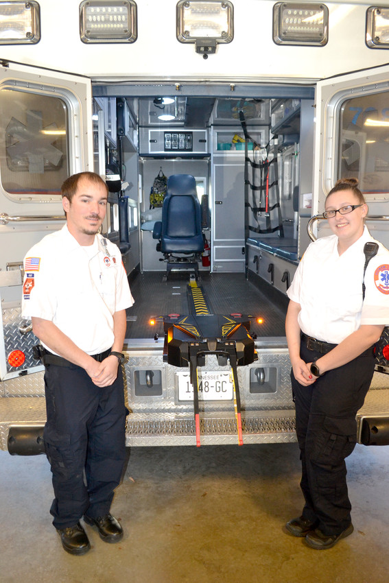 Putnam County AEMTs Johnathan Price, left, and Kasie Henley show off the new Power load system that's been added to several ambulances.