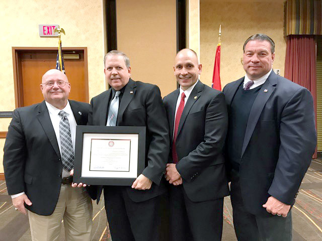 The Putnam County Sheriff's Office became the third sheriff's office in the state Wednesday to be accredited by the Tennessee Law Enforcement Accreditation. From left are Tennessee Associations of Chiefs of Police President Kevin Arnold, PCSO Sgt. Fred Parker, PCSO Lt. Rick Baker and Sheriff Eddie Farris.
