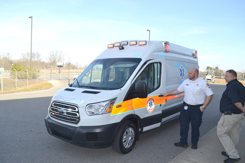 EMS Director Tommy Copeland, right, and assistant director Darren Ford look over a new ambulance that will soon be in service.