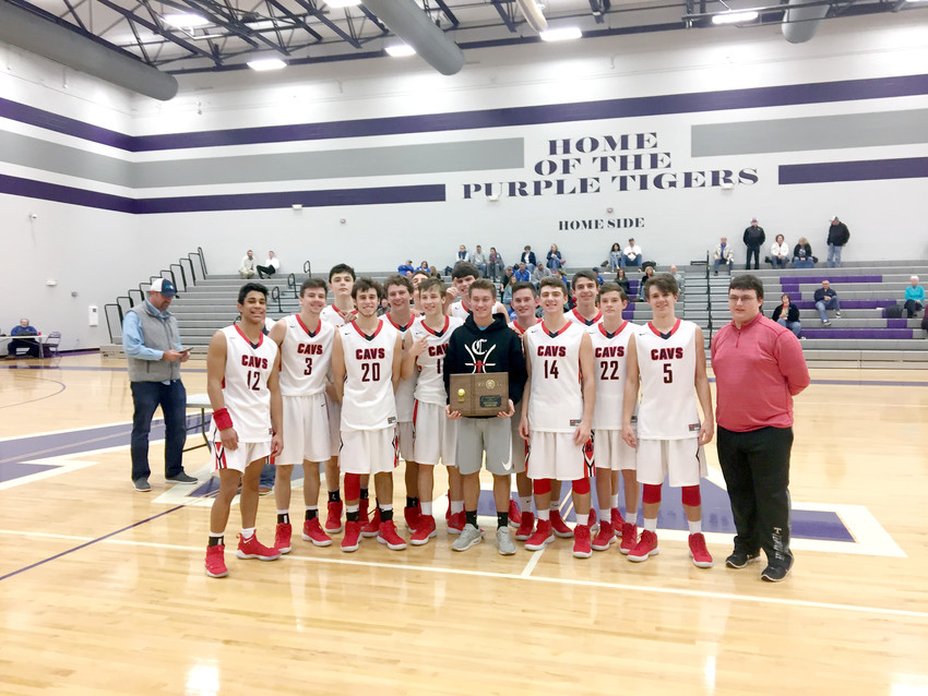The Cookeville High School Cavaliers are pictured above with their championship trophy after beating Macon County Saturday in the title game of the Watertown Holiday Basketball Tournament.