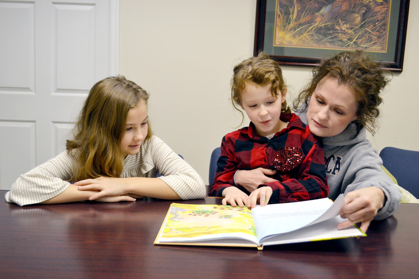 Cookeville author Bethany Stevens, right, reads her new children's book to her kids, Emma and Annabella.