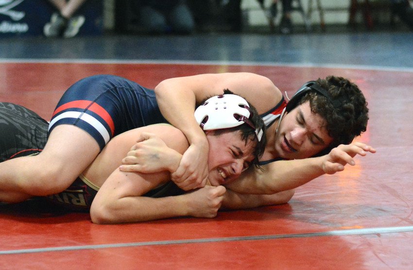 Sebastian Hirbar takes control in the match during the Cavs' win over Riverdale on Tuesday night at CHS..