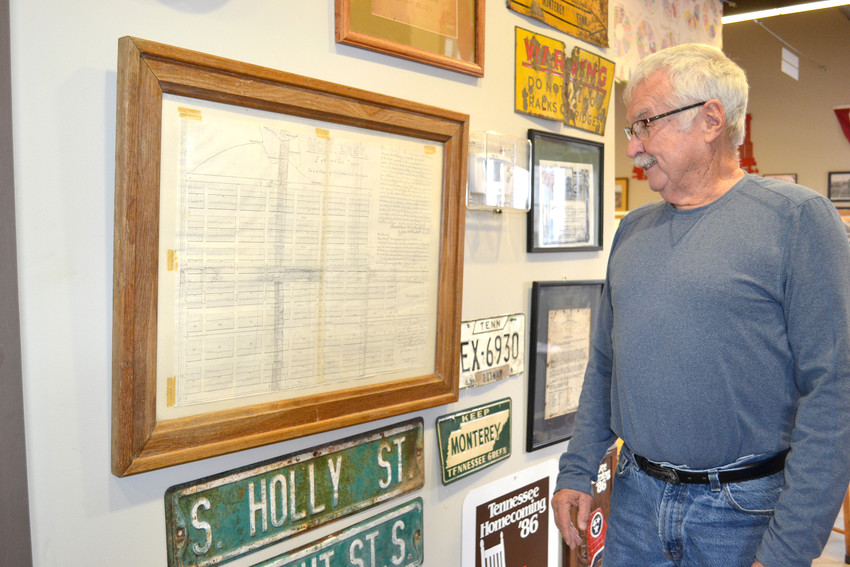 In anticipation of its 125th anniversary, Monterey Mayor Bill Wiggins gazes at the original map laying out the streets of the town.
