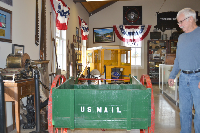 Mayor Bill Wiggins looks over a historic mail wagon on display at the Monterey Depot Museum as the town makes plans for its 125th anniversary.