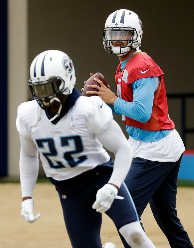 Tennessee Titans quarterback Marcus Mariota (8) runs a drill with running back Derrick Henry (22) during an NFL football practice Wednesday, Jan. 10, 2018, in Nashville, Tenn. The Titans are scheduled to play the New England Patriots in an AFC divisional round playoff game Saturday. (AP Photo/Mark Humphrey)