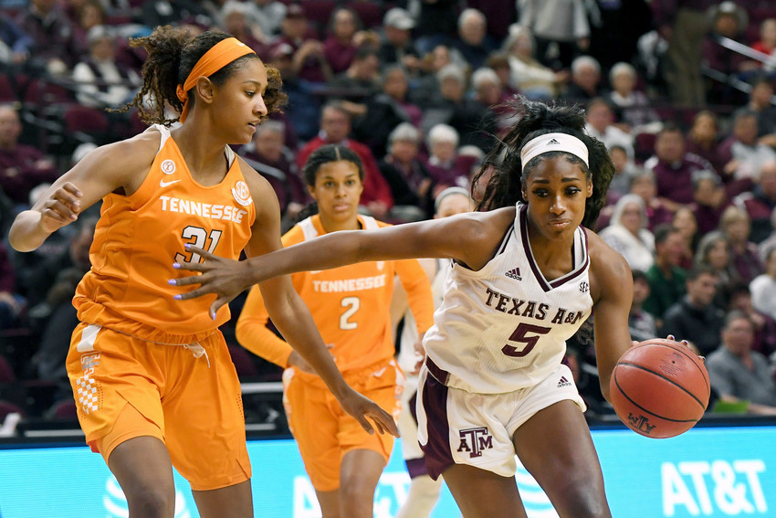 Texas A&M's Anriel Howard (5) dribbles past Tennessee's Jaime Nared (31) in the first quarter of an NCAA college basketball game Thursday, Jan. 11, 2018, in College Station, Texas. (Laura McKenzie/College Station Eagle via AP)