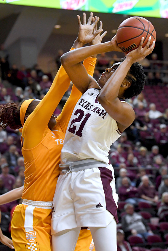 Texas A&M's Jasmine Lumpkin (21) shoots as Tennessee's Cheridene Green (15) defends during the first quarter of an NCAA college basketball game Thursday, Jan. 11, 2018, at Reed Arena in College Station, Texas. (Laura McKenzie/College Station Eagle via AP)