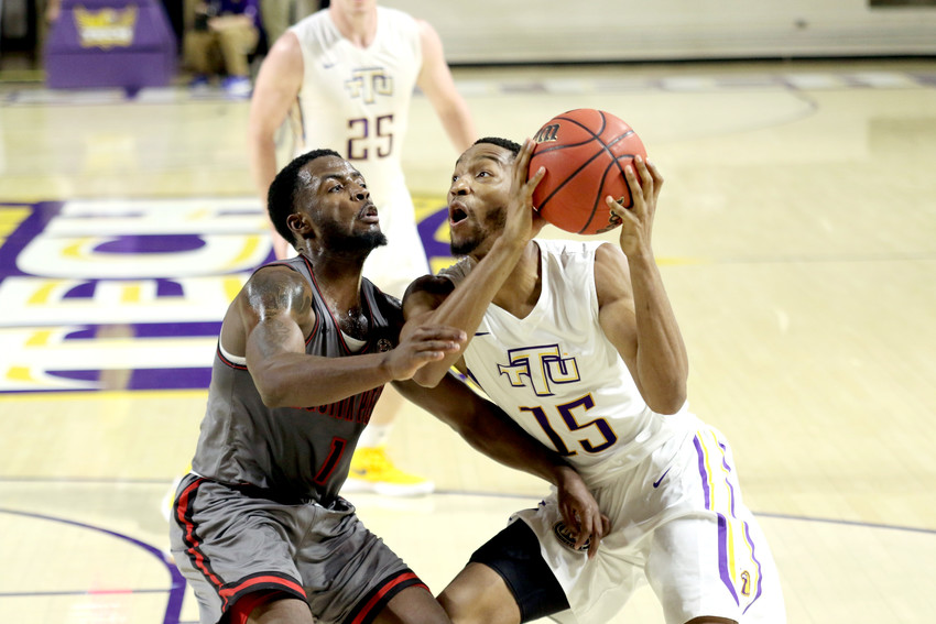Tennessee Tech's Curtis Phillips, right, looks to put up a shot past an Austin Peay defender during the Golden Eagles' 86-74 victory over the Governors on Thursday night at the Hooper Eblen Center in Cookeville.