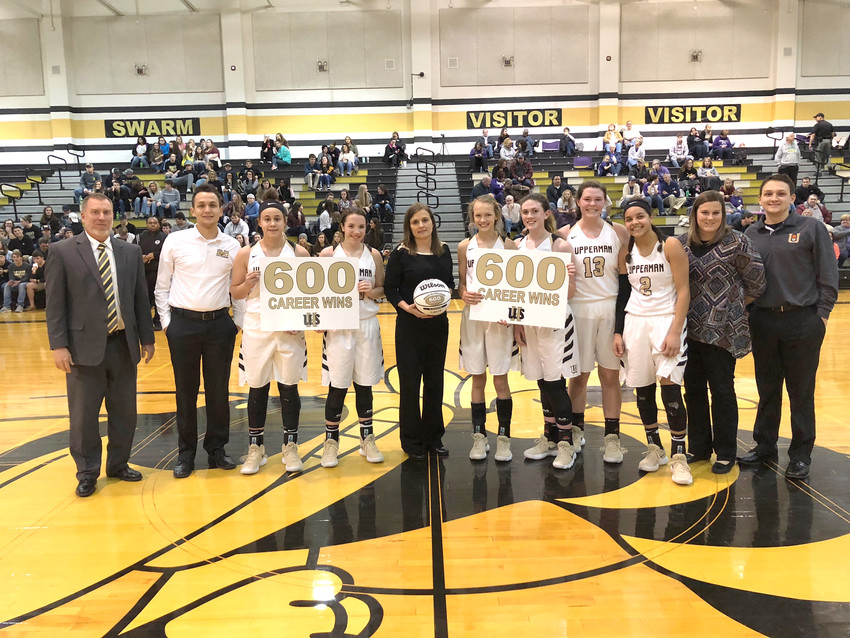 "Upperman High School coach Dana McWilliams, center, was honored for earning her 600th career coaching victory Tuesday night after the Lady Bees rolled over visiting Watertown High School, 71-28. McWilliams said she's been very fortunate to have ""great players and great teams"" over the years. Upperman will be back in action Friday for a doubleheader at Livingston Academy."
