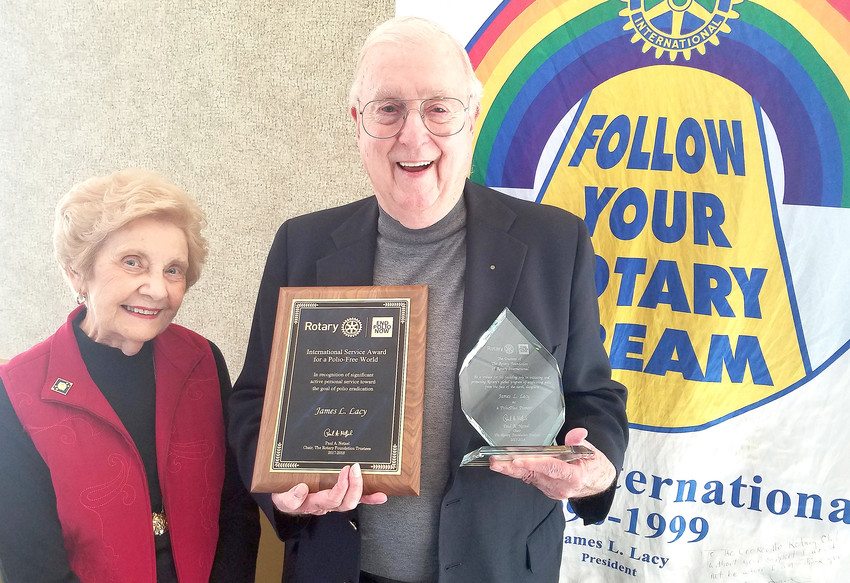 James L. Lacy and his wife, Claudine, proudly display the two prestigious awards he received for his years of service and support to Rotary International's ongoing efforts of eradicating polio.
