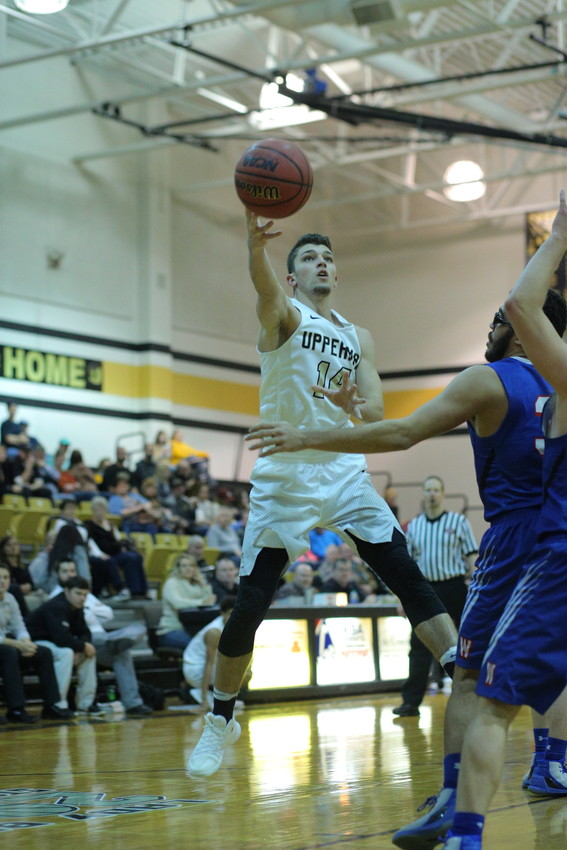Upperman's Jaydon Kanipe goes up for two points.