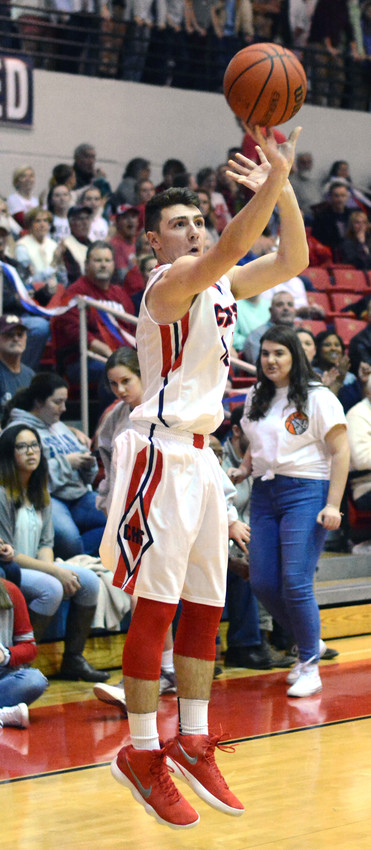 Hunter Vick goes up for a shot during the Cavaliers' game with White County Tuesday night.