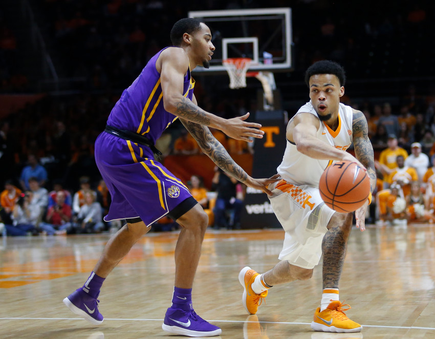 Tennessee guard Lamonte Turner, right, passes the ball as LSU guard Daryl Edwards defends during the first half of an NCAA college basketball game Wednesday, Jan. 31, 2018, in Knoxville, Tenn. (AP Photo/Crystal LoGiudice)