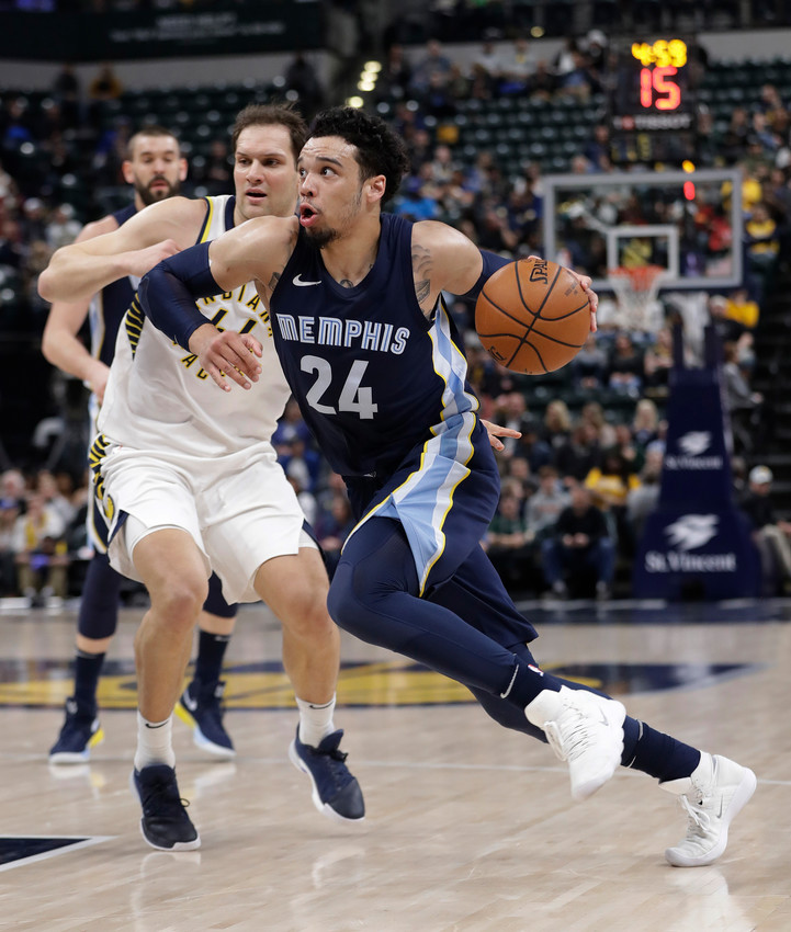 Memphis Grizzlies' Dillon Brooks goes to the basket against Indiana Pacers' Bojan Bogdanovic during the first half of an NBA basketball game Wednesday, Jan. 31, 2018, in Indianapolis. (AP Photo/Darron Cummings)