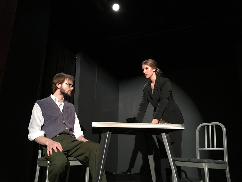 """Mr. Doyle,"" played by James Alder, is questioned by ""Detective Morris,"" played by Ashley Wheeler, concerning his activities in ""The Nether."""