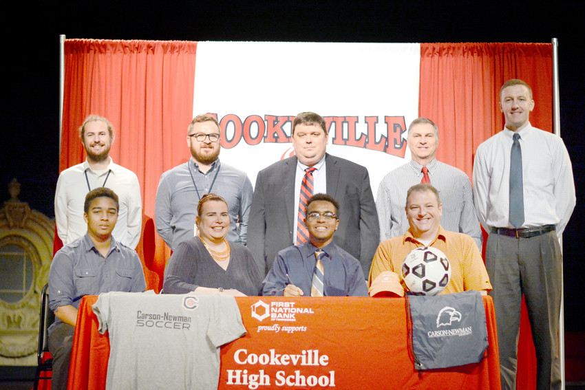 Cookeville's Ryan Lombardo (first row, second from right) signs his national letter of intent to play soccer for Carson Newman University on Wednesday at CHS. The signing was witnessed by (front row, from left) brother Alex Lombardo, mother Kathryn Lombardo, father Michael Lombardo, (back row, from left) CHS head coach Sam Matson, CHS assistant coach Will Putman, CHS principal Clif Matlock, CHS athletic director Steve Robbins, and personal trainer David Kneiling.
