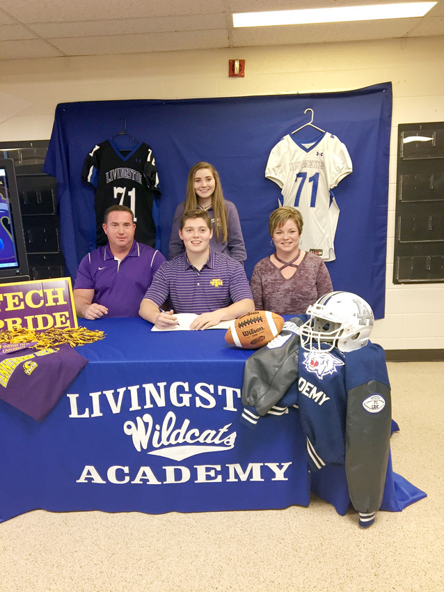 Livingston Academy senior Jarrett Key, front row, center, recently signed a national letter of intent to play football next year at Tennessee Tech during ceremonies at the high school. Joining Jarrett were, front row, from left: Wayne Key, father; Jarrett; Christie Key, mother; back row: Jordan Key, sister.