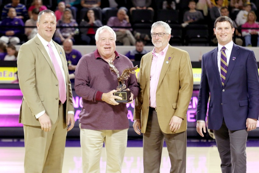 Randy Smith (second from left), former Tennessee Tech athletic standout and long-time veteran tennis coach, was honored recently with the 2018 Athletics Outstanding Alumni Award. Smith is joined in the celebration by, from left: athletics director Mark Wilson, president Phil Oldham and Brandon Boyd.