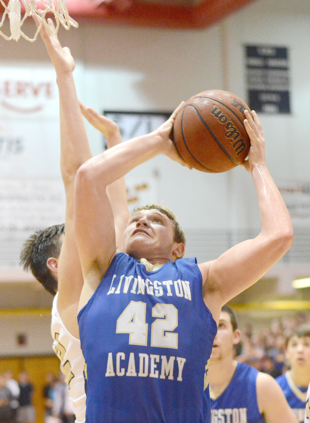 Livingston's Jacob Craig puts up a layup during the Wildcats' 72-48 win over Upperman High School in the Region 4-AA championship on Thursday night at Cookeville High School.