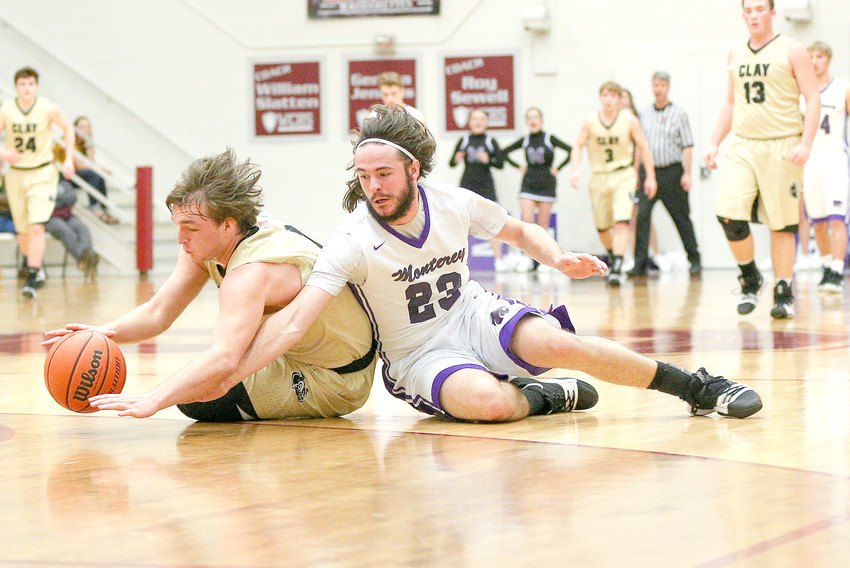 Monterey's Grayson Randolph, right, fights for a loose ball during the Wildcats' 71-67 win over Clay County on Thursday in the Region 3-A Tournament's championship at White County High School.