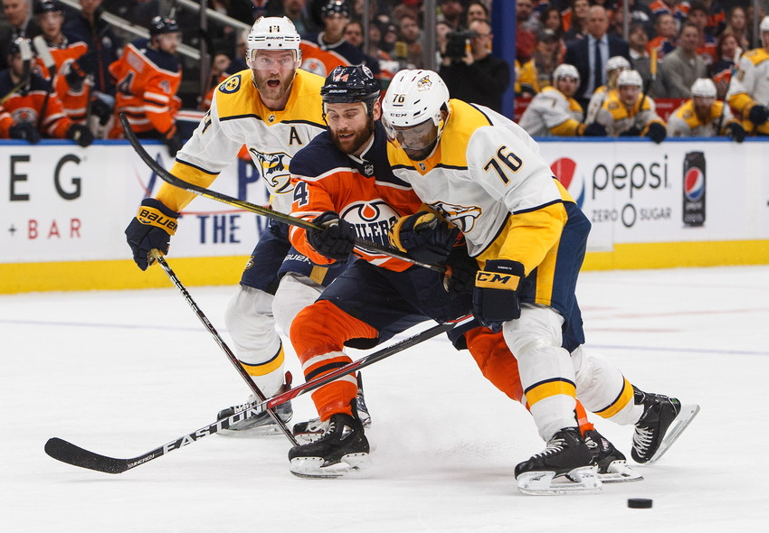 Nashville Predators' Mattias Ekholm (14) and P.K. Subban (76) battle for the puck with Edmonton Oilers' Zack Kassian (44) during the second period of an NHL hockey game Thursday, March 1, 2018, in Edmonton, Alberta. (Jason Franson/The Canadian Press via AP)