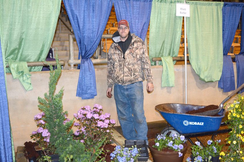 Rhett Butler is a landscaper that is setting up his booth for the show.
