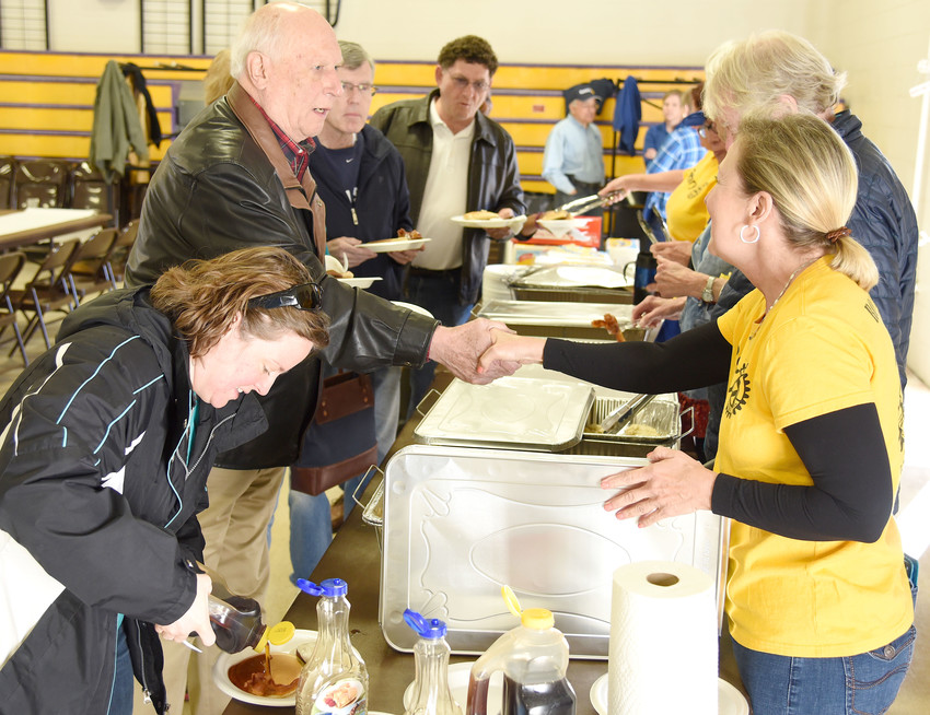 Rotarians served pancakes, bacon, sausage and biscuits and gravy Saturday to hundreds who lined up to support Rotary scholarships in the Upper Cumberland.
