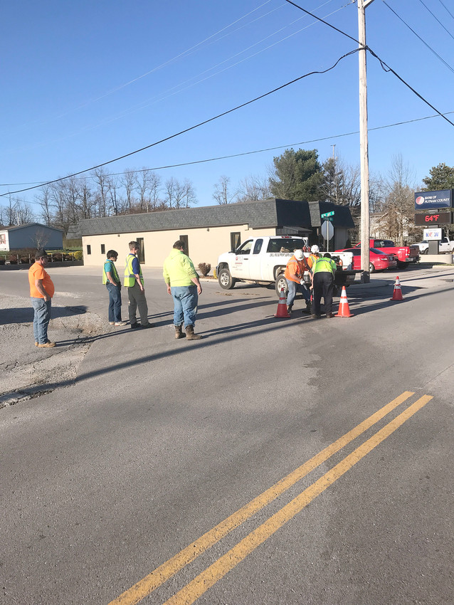 Crews from Knoxville-based Performance Contractors get equipment in place to start smoke testing on Baxter's sewer system.